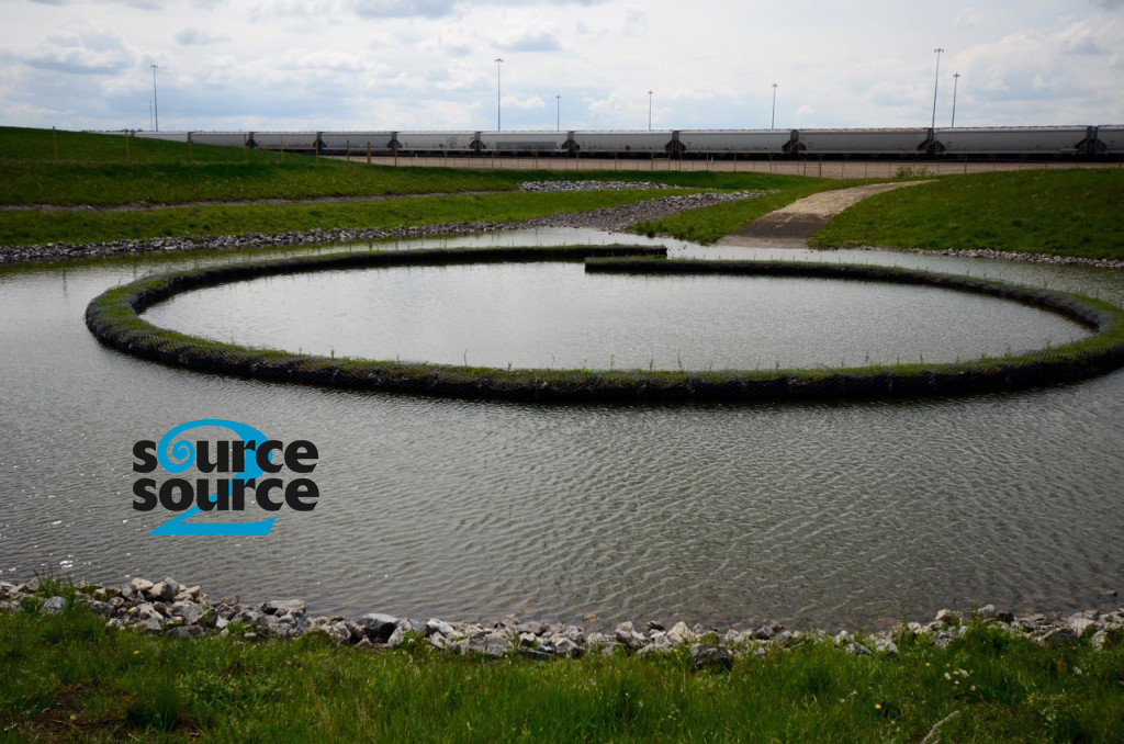 "Completed Joffre stormwater Nautilus Pond™, June 2015. <em>Photo used with permission from <a href=""http://source2source.ca/nautilus-pond/"" target=""_blank"">Source2Source Inc.</a></em>"